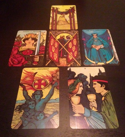 Four of Wands, Queen of Swords, Ten of Coins, The High Priestess, Judgment, Two of Cups